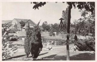 Ansichtkaart Haren Avondlicht Tuin zuidzijde met klokkenstoel 1946 HC3076