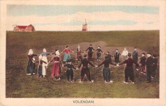 Ansichtkaart Volendam Kinderen in rondedans Klederdracht Molen HC19981