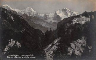 Ansichtkaart Zwitserland Interlaken Heimwehfluh Eiger Monch und Jungfrau Trein Spoorwegen Schweiz Suisse Switzerland Europa HC24164